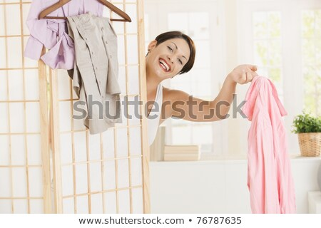 Happy woman behind dressing panel Stock photo © nyul