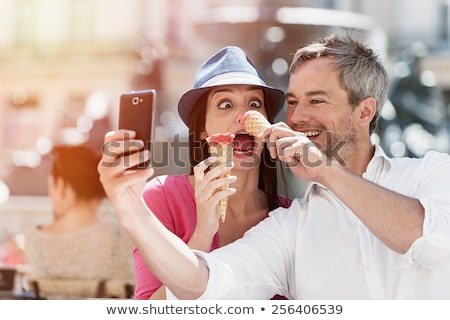 Couple texting about funny pictures Stock photo © wavebreak_media