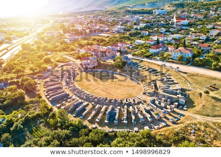 ancient salona or solin amphitheater aerial sunset view stock photo © xbrchx