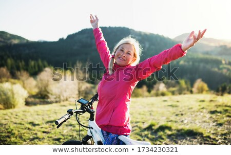 Elöl kilátás boldog idős nő bicikli Stock fotó © wavebreak_media
