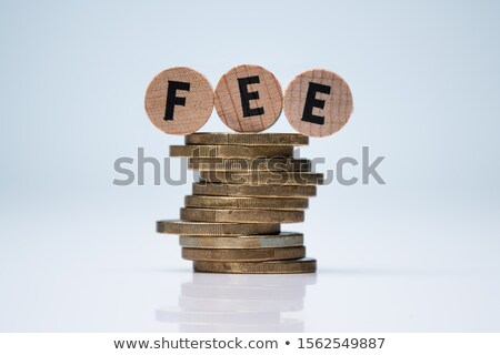 Blocks With Fee Text Above Stacked Coins On Desk Stock photo © AndreyPopov