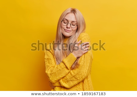 Relaxation concept. Pretty girl with pleased satisfied expression, dressed in pyjamas, rests in bed, Stock photo © vkstudio