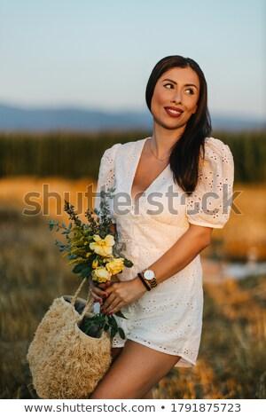 положительный женщины брюнетка белый подвенечное платье букет Сток-фото © vkstudio
