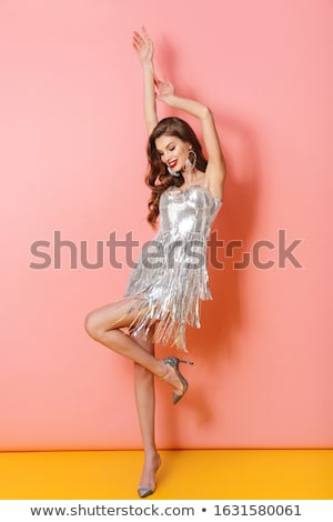 Cheery young woman in bright sequins dress Stock photo © deandrobot