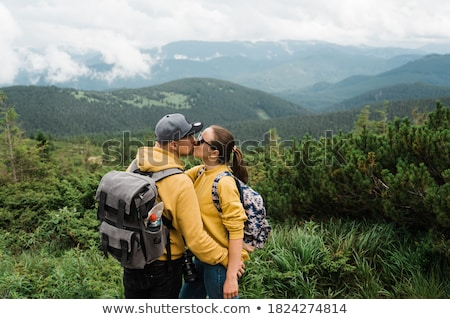Man and woman tourists in the honeymoon against the background of the sea Angel's Billabong in Nusa  Stock photo © galitskaya