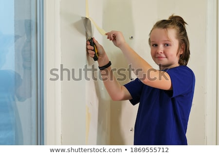 boy breaks wallpapers from  wall Stock photo © Paha_L