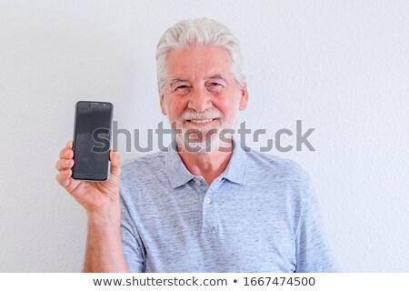 Mature businessman hold phone close-up portrait Stock photo © CandyboxPhoto