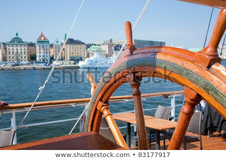 Ship helm and a view on Stockholm, Sweden Stock photo © photocreo