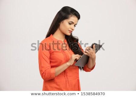 fiatal · nő · olvas · ekönyv · elektronikus · könyv · ül - stock fotó © lunamarina