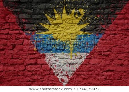 Flag of Antigua and Barbuda on brick wall Stock photo © creisinger