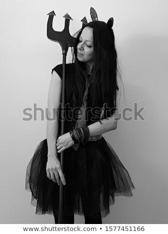 portrait of female devil holding fork stock photo © photography33