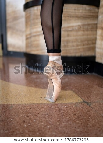 Stock photo: street dancer on the floor pointing