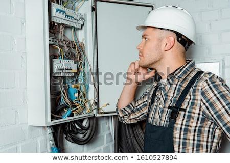 elettricista · lavoro · nuovo · costruzione · soffitto · uomo - foto d'archivio © photography33