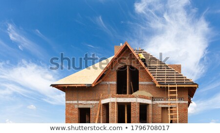 Man working on large wooden structure Stock photo © photography33
