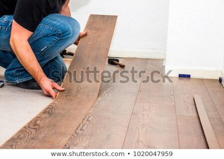 Mosaic of man with laminate flooring Stock photo © photography33
