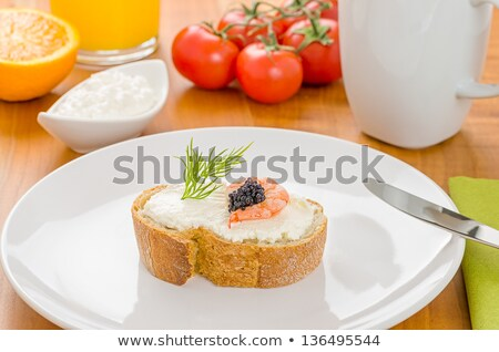 baguette with shrimp and caviar on a breakfast table stock photo © zerbor
