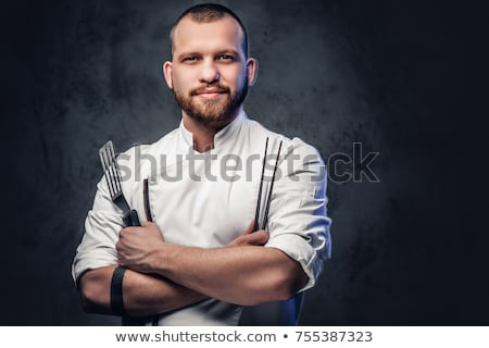 sonriendo · barbado · hombre · estufa · mirando · cámara - foto stock © dacasdo