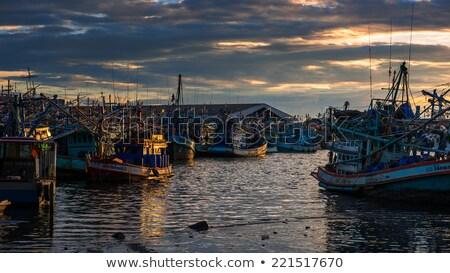 belo · pôr · do · sol · pescador · pescaria · pier · céu - foto stock © stoonn