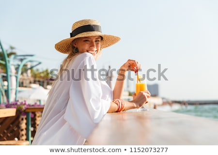 gorgeous woman sitting on beach stock photo © chesterf