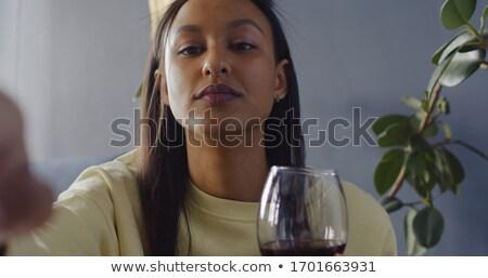 Glimlachende vrouw glas wijn witte vrouw vergadering Stockfoto © stepstock
