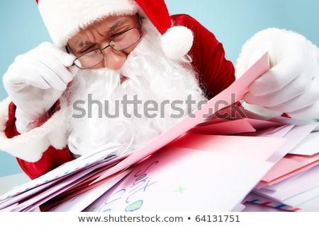 Kerstman hoop brieven lezing een Stockfoto © HASLOO