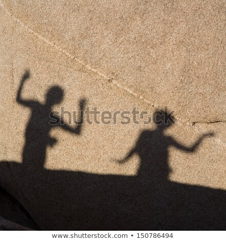 children playing with shadows on a rock Stock photo © meinzahn