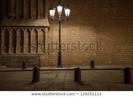 Building facade with lanterns of balconies at night Stock photo © Nejron