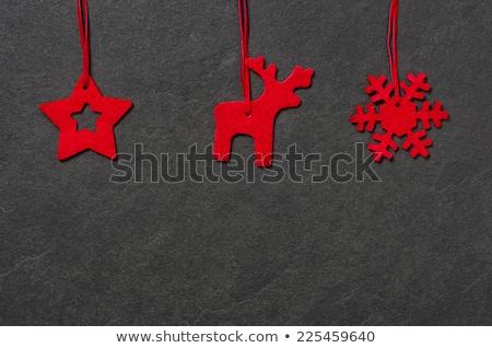 Slate board with a felt reindeer Stock photo © Zerbor