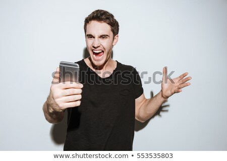 Stock photo: casual young man looking angry away from the camera