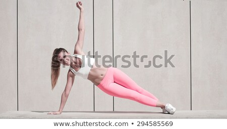 Sporty Woman Doing Side Plank Exercise on Platform Stock photo © stryjek