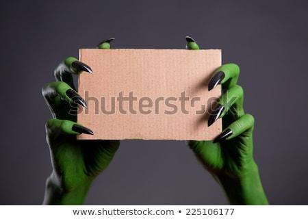 Spook hand zwarte nagels Stockfoto © Elisanth