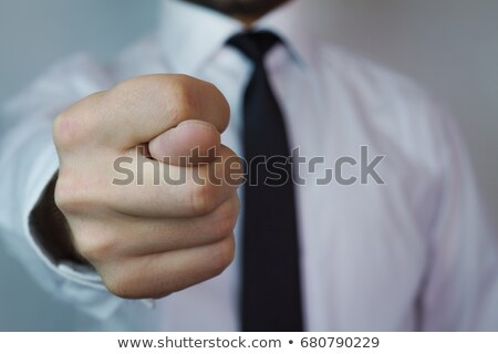 Businessman with fig hand sign Stock photo © stevanovicigor
