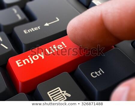 Genieten leven persoon klikken toetsenbord knop Stockfoto © tashatuvango
