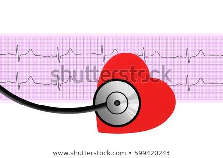 Textile heart over electrocardiogram graph on white background Stock photo © tetkoren
