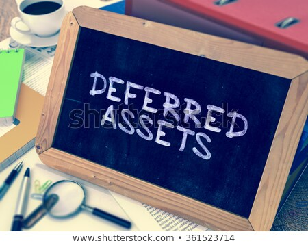 deferred assets   chalkboard with hand drawn text stock photo © tashatuvango