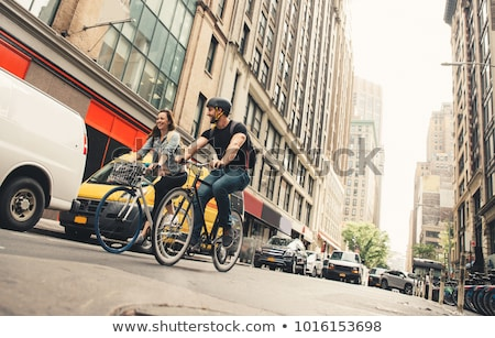 man on a bike on a crossing in manhattan nyc stock photo © lightpoet