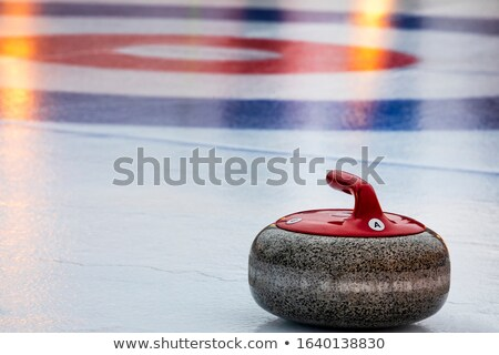 Curling stone in the target area Stock photo © magraphics