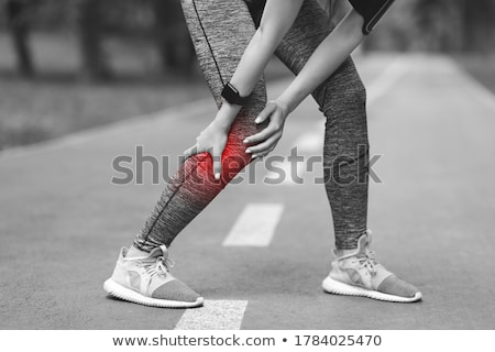 Cropped image of a runner suffering from leg cramp Stock photo © deandrobot