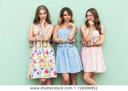 three women friens dreaming in studio stock photo © feedough