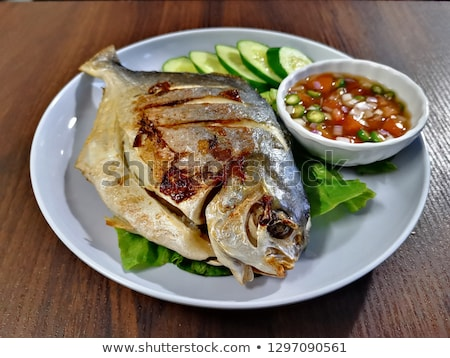 whole roasted bream with chilies potatoes and peppers stock photo © monkey_business