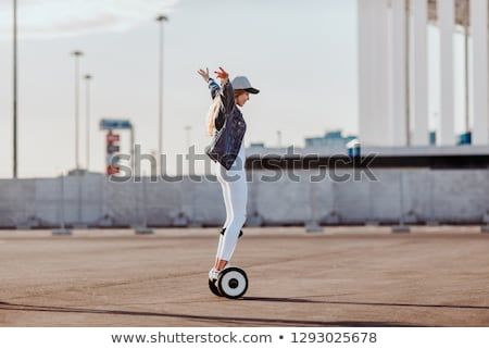 A young couple riding hoverboard - electrical scooter, personal  Stock photo © vlad_star