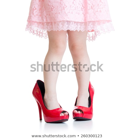 Girl trying on her mother's shoes Stock photo © IS2