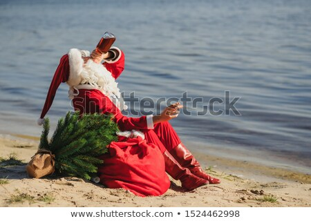santa claus on chair and drinking whiskey and smoking cigar dru stock photo © popaukropa