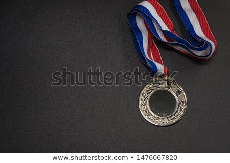 Silver medal with ribbon on blue background Stock photo © studioworkstock