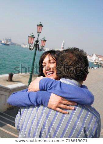 Portrait of couple hugging near lagoon Stock photo © IS2