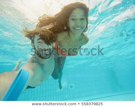 Lány barát búvárkodik vízalatti üdülőhely úszómedence Stock fotó © Kzenon