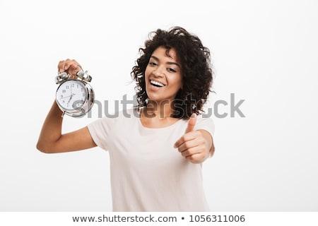 Mutlu kadın yalıtılmış çalar saat bakıyor Stok fotoğraf © deandrobot