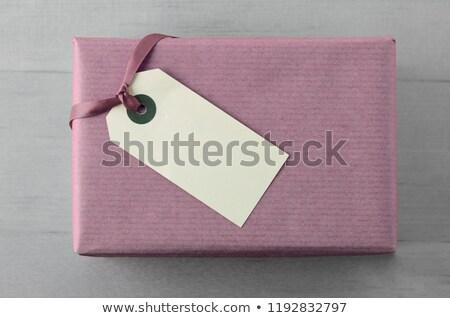 Hediye kutusu leylak rengi kâğıt etiket şerit görmek Stok fotoğraf © frannyanne