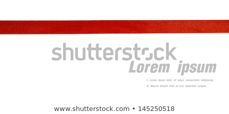 Shiny red satin ribbon on white background. Stock photo © fresh_5265954