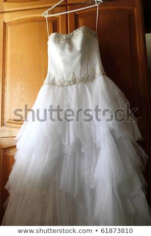 Esküvői ruha akasztás konyhaszekrény tv nő szeretet Stock fotó © ruslanshramko